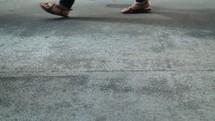 People walking on a sidewalk - 1 of 3