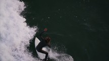 Surfers ride wave - Surf Shoot