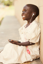joyful child listening to music on an iPod