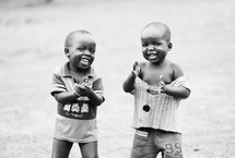 Two boys laughing and clapping.