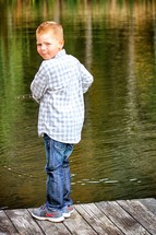 boy fishing on a dock
