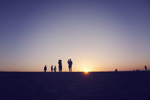 silhouette of a large family at sunset