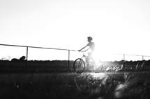 a teen boy riding a bicycle