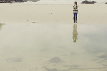 woman standing in front of a tide pool