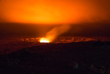glow of heat and steam from volcano