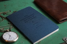 pocket watch, The Establishment and care of taking notes book, and journal