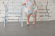 infant learning to walk
