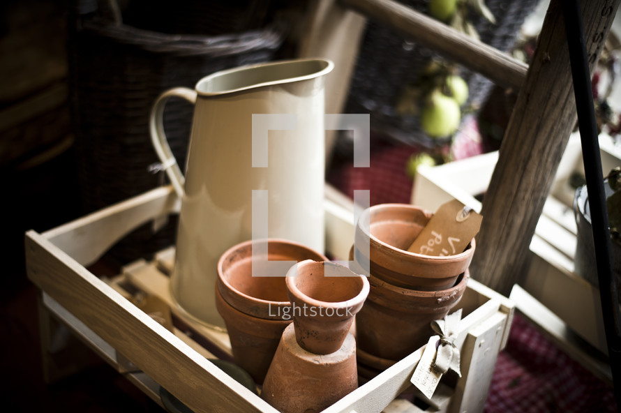 pitcher and flower pots