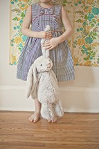 child holding a stuffed animal bunny