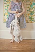 child holding a stuffed animal bunny