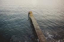 Wooden pier into the ocean.