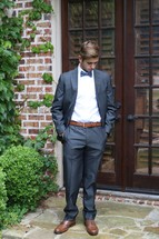 a young man in a suit and bowtie