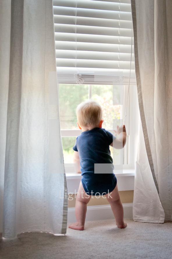 infant boy in a window