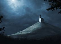 Moon light shines down on a small church