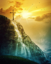 cross at the top of a waterfall and sun