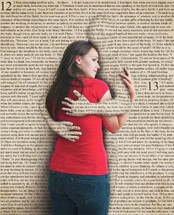 Woman embraced by pages of the Bible.