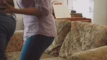 man and woman sitting down at a couch and opening their Bibles at a Bible study