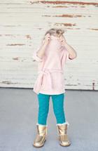 girl child hiding in her shirt