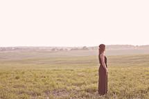 woman standing in an open field