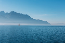 view of a sailboat from the coast of Switzerland