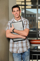 college student holding a laptop