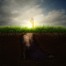 Buried alive - a woman buried under the ground, reaching out for help.