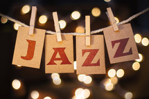 word jazz hanging on clothes pins and bokeh lights in background