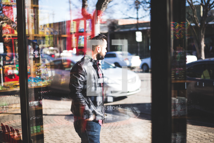 a man walking in front of a store front window