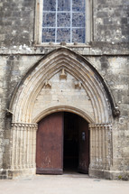 open door of an old church in France