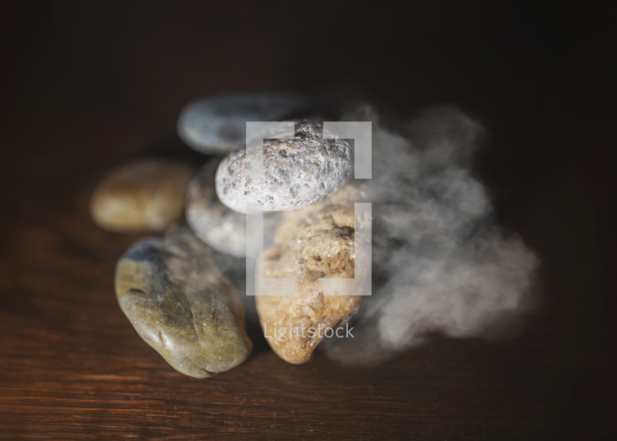 pile of rocks with cloud of smoke