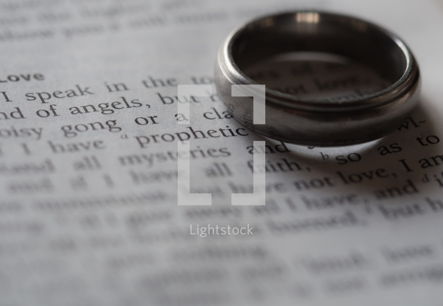 wedding band on the page of a Bible
