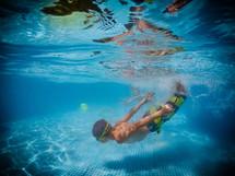 boy diving under water
