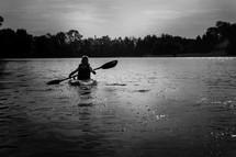 boy paddling a kayak
