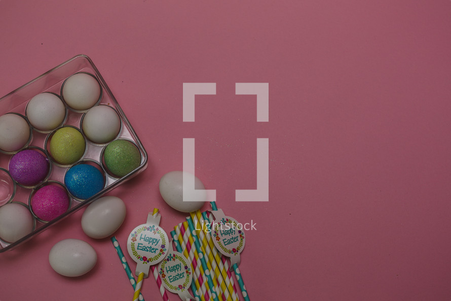 Easter eggs in a carton and Easter straws