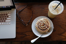 cinnamon bun and iced coffee