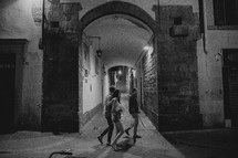 people walking on the narrow streets of Italy at night