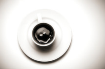 A cup of coffee on a saucer
