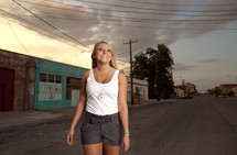 Girl walking down the street smiling