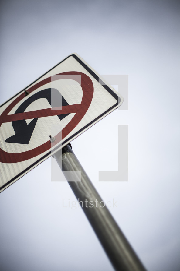 closeup of no u turn street sign