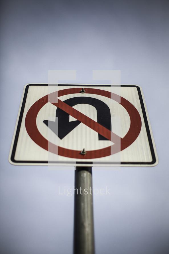 closeup of no u turn sign