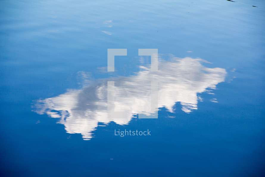 reflection of a cloud on lake water