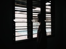 a young man looking out a window