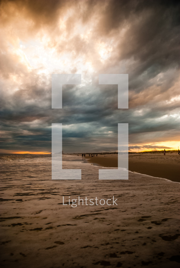 Stormy beach at sunset.