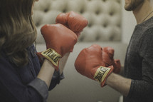 couple wearing boxing gloves