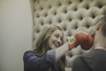 playful couple boxing