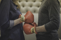 boxing couple touching gloves