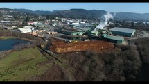 Aerial Video of Lumber Mill and Coastal Town