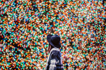 you woman surrounded by colorful bokeh lights
