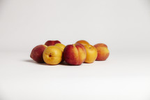 a group of peaches on seamless white