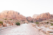 homes carved into red rock cliffs